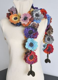 """This scarf has 51 pcs of 3.5"""" hand crochet flowers. The length from end to end is about 59""""/150cm. The length can be made to order.     The yarn is 66% wool and 34% acrylic blend and linen/ wool blend . $39"""