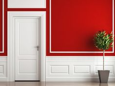 Red Walls & White Molding White picture frame molding gives this bold red room a classic touch.