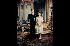 Royal Engagement  Princess Elizabeth stands with her fiancee Lieutenant Philip Mountbatten, Prince of Greece and Denmark at Buckingham Palace on August 19, 1947.