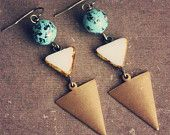 thora. a pair of teal and white geometric earrings.