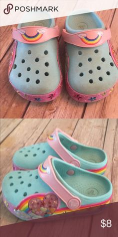 Toddler crocs Play to good condition. Magic eraser may clean them up. Light up CROCS Shoes