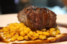Bison (Buffalo) Hip Steak garnished with Sweet Corn and Balsamic Reduction Jus