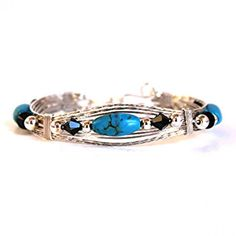 Bracelet - made with sterling silver wire, turquoise beads, Swarovski crystals and silver plate beads.