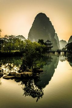 Guangxi is an autonomous region of southern China along its border with Vietnam. Formerly a province, Guangxi became an autonomou. Places To Travel, Places To See, Travel Destinations, Beautiful World, Beautiful Places, Amazing Places, Beautiful Sunset, China Travel, Places Around The World