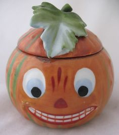 Antique Halloween German Porcelain Jack O Lantern Container, with Leafy Lid.