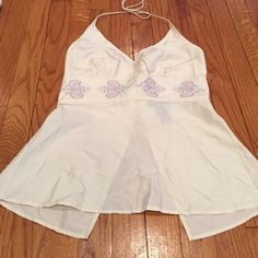 Express cream halter Cream colored 100 % silk babydoll halter. Beautiful embroidered design. Hook and eye closure in back. Size 3/4 from Express. Express Tops Crop Tops