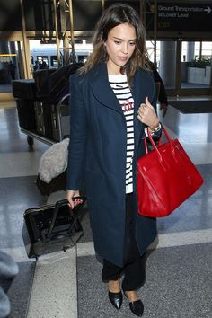 Jessica Alba looking casual, but chic in an over sized navy trench coat