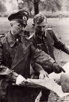 Generalfeldmarschall Walter Model and Oberstleutnant iG (im Generalstab) Kurt Kauffmann are discussing the development of the battle through the map