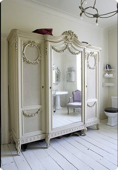 Love the mirrored, shabby chic armoire. <3