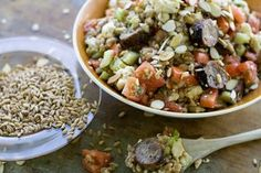 A dish of warm farro salad with grilled Italian sausage. The ancient grain is easy to prepare. MATTHEW MEAD / Associated Press