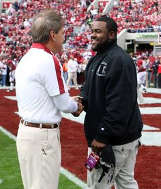 Head coach Nick Saban of the Alabama Crimson Tide shakes hands with former Alabama running back, Heisman Trophy winner and New Orleans Saints running back Mark Ingram before the game against the Georgia Southern Eagles at Bryant-Denny Stadium on November 19, 2011 in Tuscaloosa, Alabama.