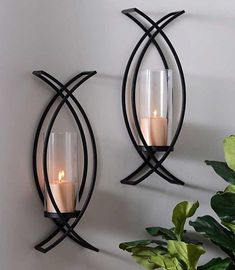 """Charlie Crisscross Sconces, Set of 2 Want to give your living space a twist? Try our """"Charlie Crisscross Sconces!"""" After All, the best things in life come in pairs. Wall Candle Holders, Candle Wall Sconces, Candle Wall Decor, Metal Tree Wall Art, Metal Wall Decor, Diy Wall, Iron Wall Art, Metal Art, Sconces Living Room"""