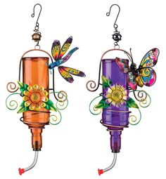 Regal Metal Hummingbird Feeders with Bright Floral accents, Butterfly and Dragonfly. Enjoy the sight and sound of wildlife in your garden, on your porch, or in a window with a lovely enameled metal and colored glass hanging hummingbird feeder.