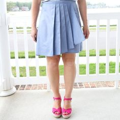 Make an flattering pleated faux wrap skirt this Spring or Summer using our free women's skirt pattern.