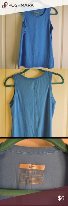 Nike Fit Dry Sports Tank Blue sports tank. There is a small stain on front lower side. Smoke and pet  free home. No trades. Open to offers. Nike Tops Tank Tops