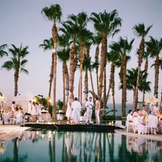 Evening Poolside Wedding Reception -- and *everyone* is in white (guys with khaki)
