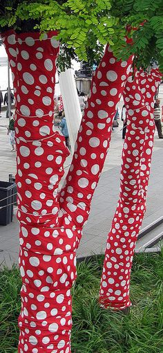 Inspiration - wrap tree trunks in vinyl or fabric. What a GREAT outdoor decorating idea!