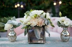 Fresh flowers in silver and grey vases. Love how the look is modern, whimsy and fresh.