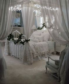 Romantic white shabby chic bedroom. Heavy use of vintage distressed white for an ambience of old fashioned charm and romance.