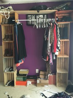 DIY cloves rack---using wooden crates. Closet rod goes in between opening of crate.