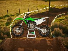 """Excellent model Kawasaki """"Dirt bike"""" category. The new 2014 Kawasaki KX100 has the engine type two-stroke single with KIPS with displacement of 99cc. New Kawasaki Dirt bike is available in Lime Green color, features Six-speed, Digital CDI ignition and Liquid cooling system. Read more about the new Kawasaki"""