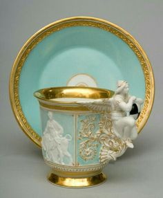Stunning porcelain cup and saucer. 24k gold gilt