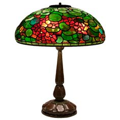Tiffany Studios Nasturtium Table Lamp  U.S.A.  circa 1906  A Tiffany Studios Nasturtium leaded glass and bronze Table Lamp with an original reticulated heat cap, signed.