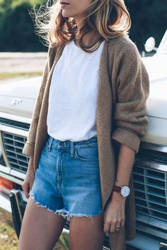 late summer style in denim shorts and a camel cardigan