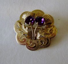 Gold plated 2.5m scottish thistle brooch engraved 2 purple stones quality item