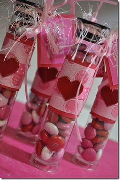test tubes but were sold as organizational storage.  fill 'em up with V-Day M&M's, covered with paper, heart brads and added a stamped tag with ribbon.