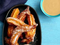 Get Food Network Kitchen's Churros With Coconut Sauce Recipe from Food Network