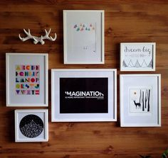 gallery wall in a nursery, black and white art, antlers