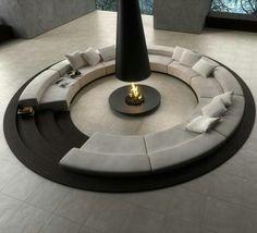 Modern Circle Sofa Surrounding A Black Fireplace