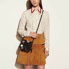 Coach Hong Kong Official page | VARSITY PATCH TURNLOCK SADDLE BAG 17 IN GLOVETANNED LEATHER