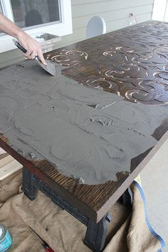 This is a cool project, they used a CNC to carve the table and filled carved parts with cement.