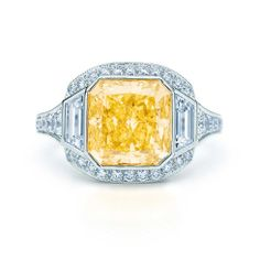 Fancy Vivid Yellow Diamond Ring in platinum with round and baguette diamonds.   Tiffany & Co.