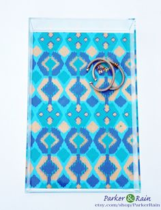 Peacock Blue & Gold Ikat Lucite Tray. $75.00, via Parker