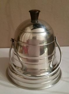 Check out this item in my Etsy shop https://www.etsy.com/uk/listing/261082259/vintage-aluminium-bell-shaped-tea