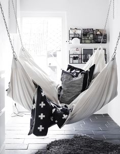 This dreamy white hammock with cosy black blanket would be the perfect nook for curling up with a good book.
