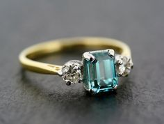 Vintage Blue Zircon Engagement Ring - Vintage Blue Zircon -would prefer this in platinum but still beautiful Vintage Blue Zircon Engagement Ring - Vintage Blue Zircon -would prefer this in platinum but still beautiful Colored Engagement Rings, Diamond Engagement Rings, Wedding Rings Vintage, Vintage Rings, Antique Jewelry, Vintage Jewelry, Blue Zircon, Pretty Rings, One Ring