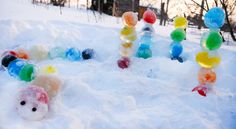 Bring colour to the deep freeze of winter with beautiful coloured ice orbs—perfect for creating towers, animals and more! Bring colour to the deep freeze of winter with beautiful coloured ice orbs — perfect for creating towers, animals and more! Snow Much Fun, Snow Fun, Winter Kids, Winter Art, Winter Christmas, Winter Outdoor Activities, Snow Activities, Indoor Activities, Outdoor Games