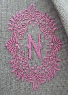 Julia B. A28 Medallion Monogram in French Rose embroidery thread on coffee linen