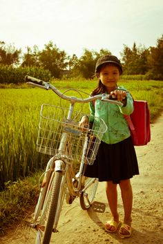 Vietnam small girl, large bicycle