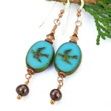 """The one of a kind """"Touch the Sky"""" handmade earrings feature turquoise blue colored Czech glass swallow beads with a Picasso finish, brown freshwater pearls, Swarovski crystals, copper and sterling silver - unique jewelry."""