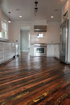 Reclaimed wood floors, subway tile & concrete counters