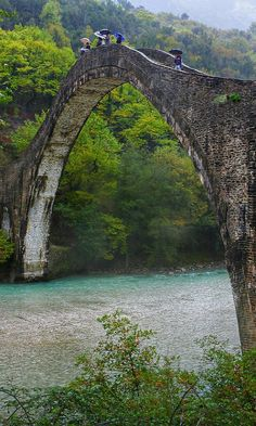 Walk over the Old bridge of Plaka over Arachthos river, a typical landscape of Epirus, Northwestern Greece. This bridge, built exclusively with stones in the century, is considered to be the largest amongst the Balkan countries. Places To Travel, Places To See, Travel Destinations, Greece Destinations, Places Around The World, Around The Worlds, Wonderful Places, Beautiful Places, Myconos