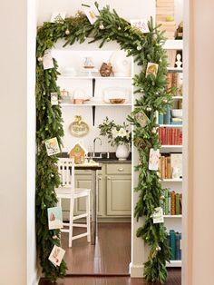 You'll forget you're entering the kitchen when you walk through this wintry evergreen arch. The evergreen garland hung around the doorway is decorative and useful -- it holds Christmas cards.  Editor's Tip: Secure the Christmas cards to the garland by tucking them neatly into the boughs or hanging them on the branches with small pieces of twine.