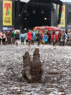 """""""Chris Cameron from Glasgow mud dives to celebrate the wet weather during the 'T in the Park' music festival at Kinross, Scotland, Sunday July (AP Photo / Andrew Milligan, PA)"""""""