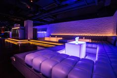 7 Heaven night club in Lan Kwai Fong, Hong Kong designed by Liquid Interiors. night club design, nightlife design, booth design, lit stairs, blue and purple, wall tile design, lit tables, cove lighting, simple and modern