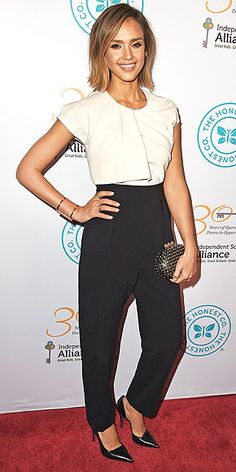 In a pleated MaxMara jumpsuit and sparkly clutch at the Independent School Alliance for Minority Affairs Impact Awards ...